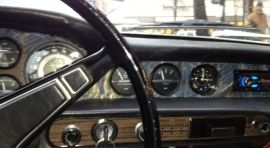 The 1972 woodgrain formica instrument panel troubled this ex-carpenter's sensibilities,  so covered it with hand made book paper.