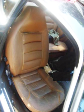 Removed the front seats and installed new ones from a Mercedes SLK, which have heated cushions and blow warm air on one's shoulders. Very spy!