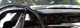 The original venal dashboard was cracked, so I stretched new Italian leather over it.